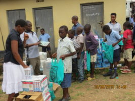 Children receive their supplies.
